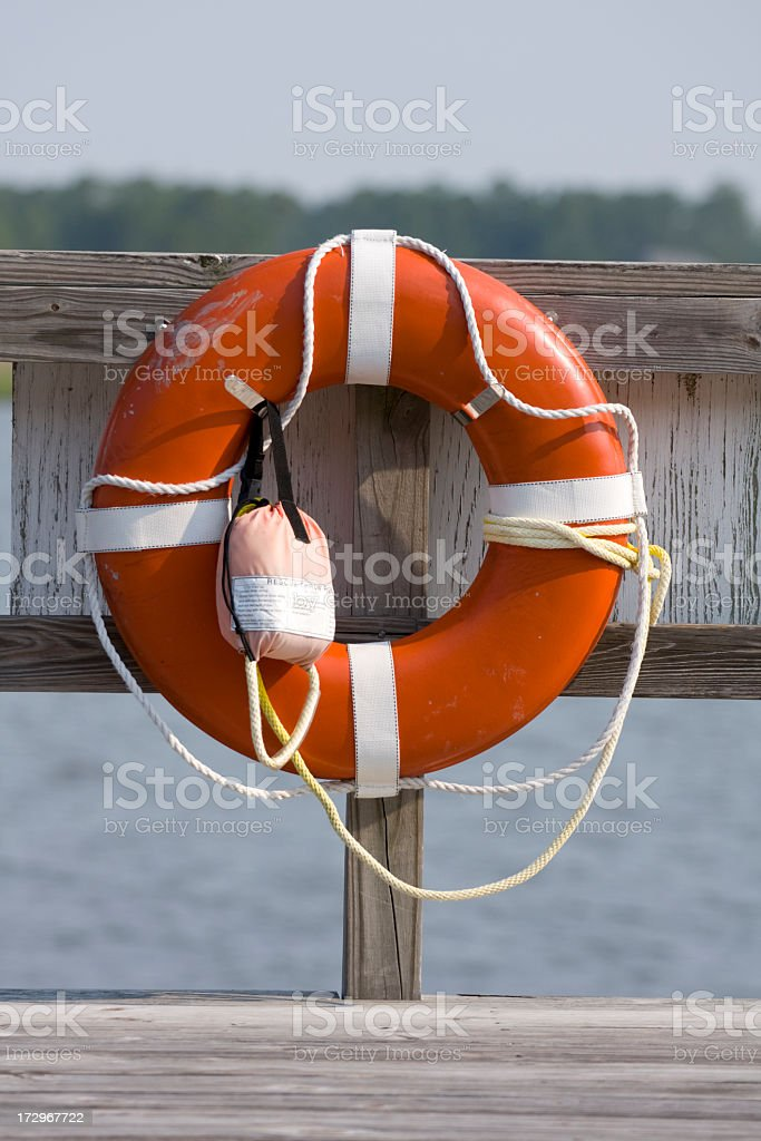 Life Buoy hanging on the dock royalty-free stock photo