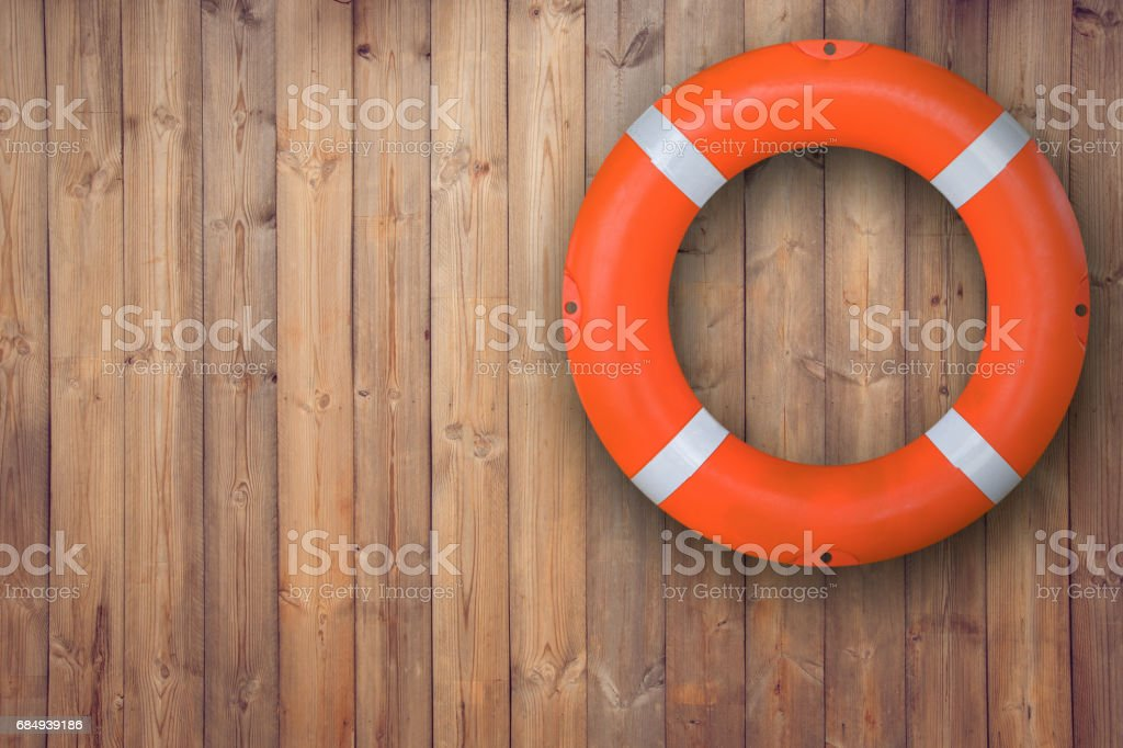 Life buoy hanging on wooden wall for emergency respone when people sinking to weter almost place neer pool and beach stock photo