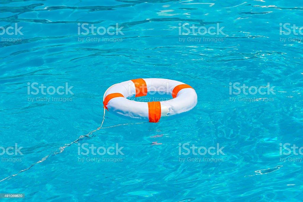 Life buoy in swimming pool stock photo