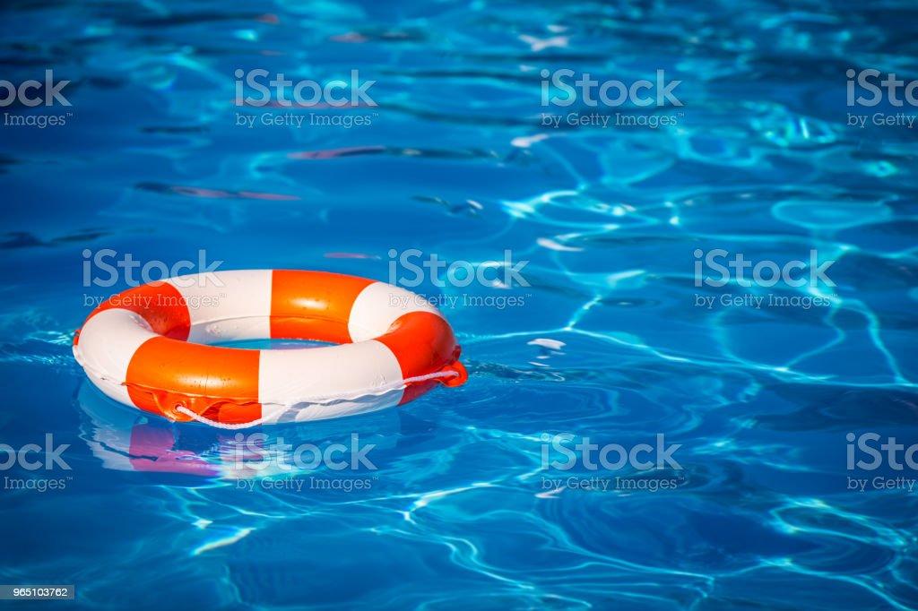Life buoy in swimming pool zbiór zdjęć royalty-free