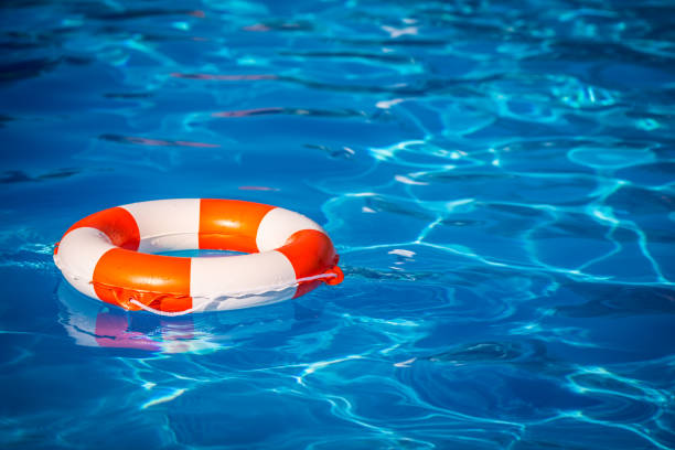 Life buoy in swimming pool Life buoy in swimming pool. Summer vacation concept buoy stock pictures, royalty-free photos & images