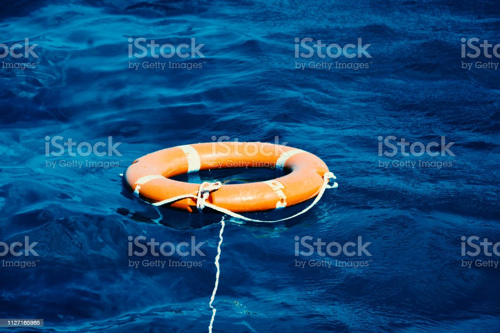 Life Buoy in the Deep Blue Sea stock photo