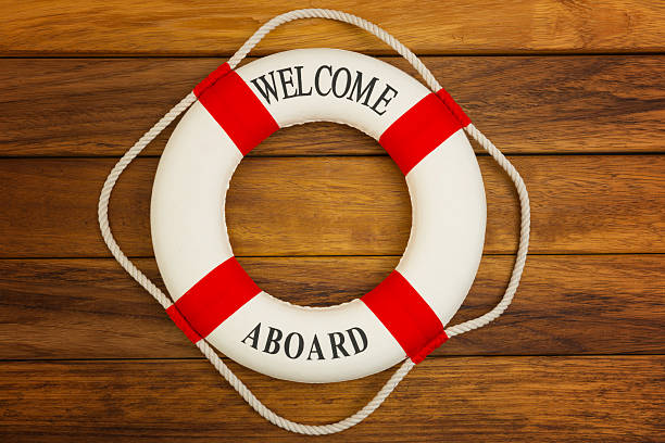 Life buoy Traditional red and white life preserver on wooden background. aboard stock pictures, royalty-free photos & images
