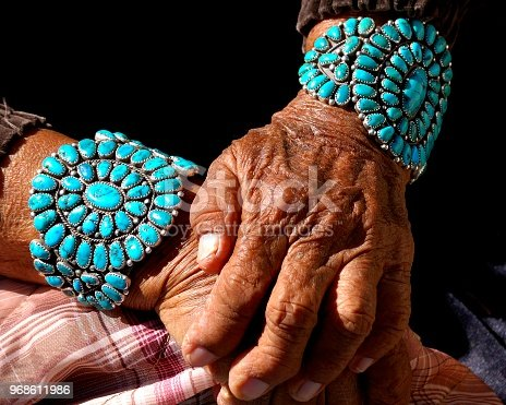 Turquoise bracelets worn by Navajo grandmother. Each stone represents a significant life event she celebrates