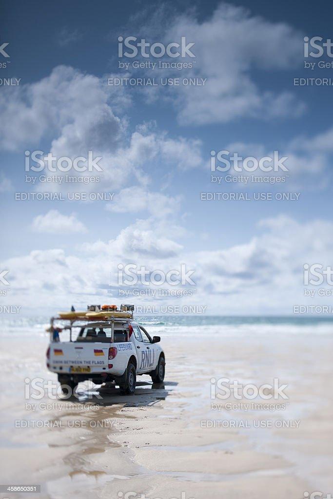 Life Guard on duty at Fistral beach, Newquay, Cornwall stock photo