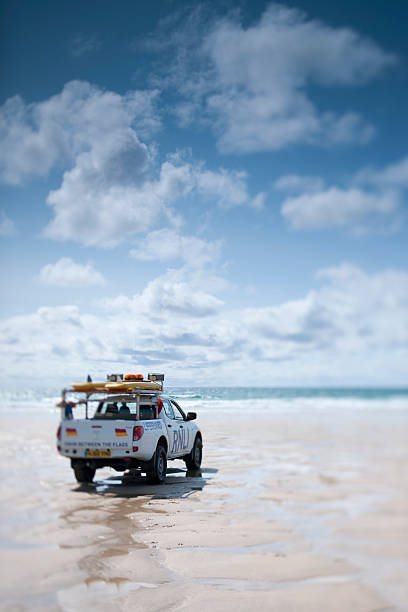 life guard on duty at fistral beach, newquay, cornwall - cornwall stock photos and pictures