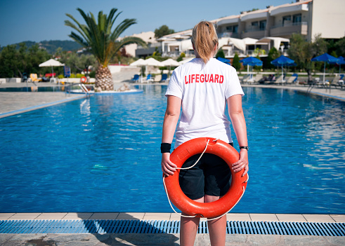 A Life Guard Standing By The Pool Stock Photo - Download Image Now