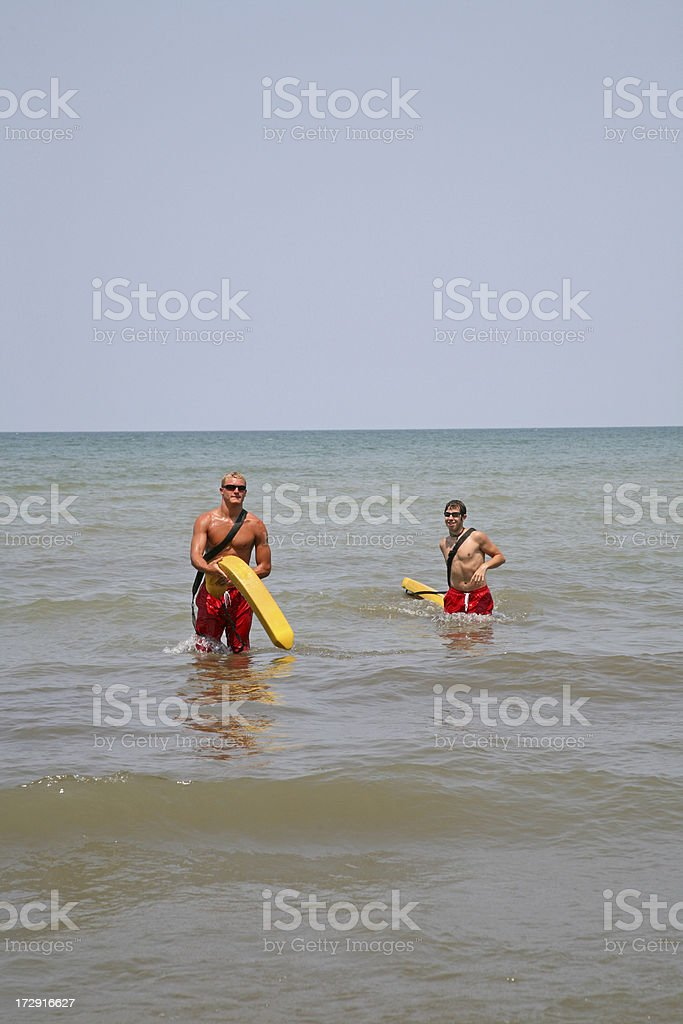 Life Guards In The Water royalty-free stock photo