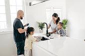 Family with two kids around kitchen island