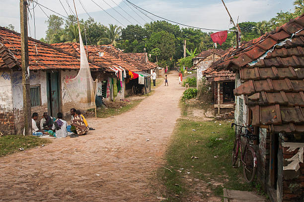 life in rural india. - village stock photos and pictures