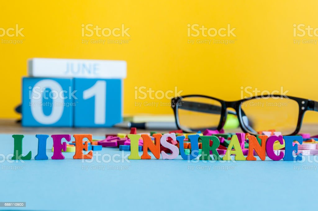 Life insurance, family services, supporting concepts. Word composed of small colored letters on business workplace of insurance agent or doctor cabinet stock photo