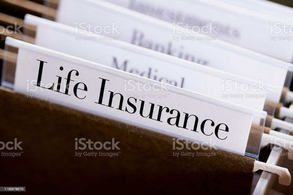 Life Insurance Files And Folders In Desk Drawer With ...