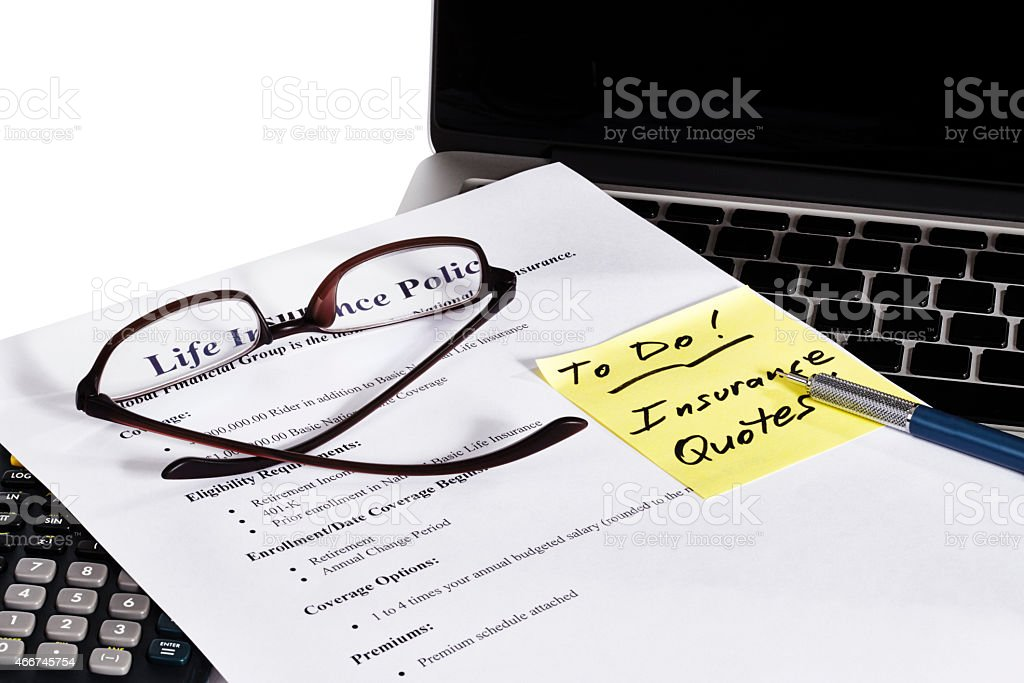 Life Insurance Policy and Office TO DO with laptop stock photo