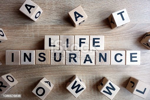 istock Life insurance text from wooden blocks 1086626838