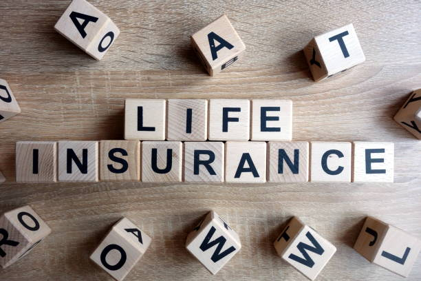Life insurance text from wooden blocks stock photo