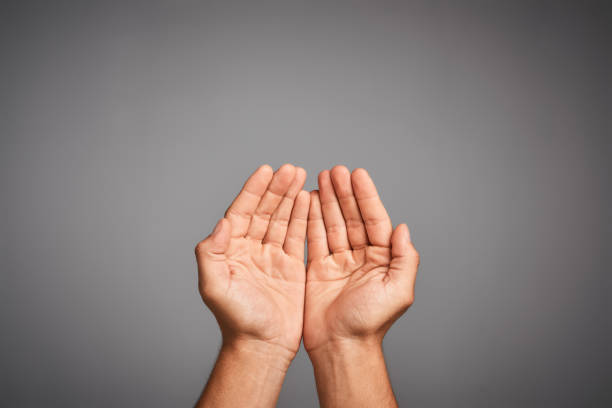 Life is all about give and take Studio shot of unidentifiable hands cupped against a gray background hands cupped stock pictures, royalty-free photos & images