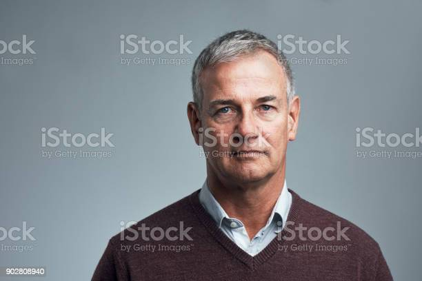Studio shot of a handsome mature man against a grey background