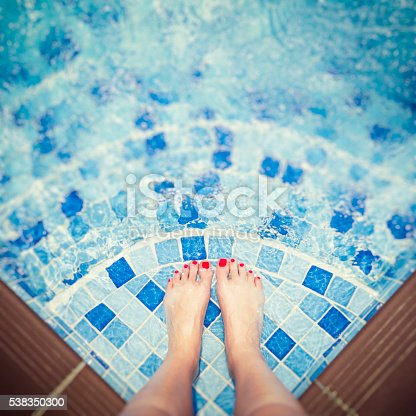 Life is better at the pool: Selfie with a wonderful mosaic pool-floor with my feet on Koh Phangan, Thailand - light bokeh effect
