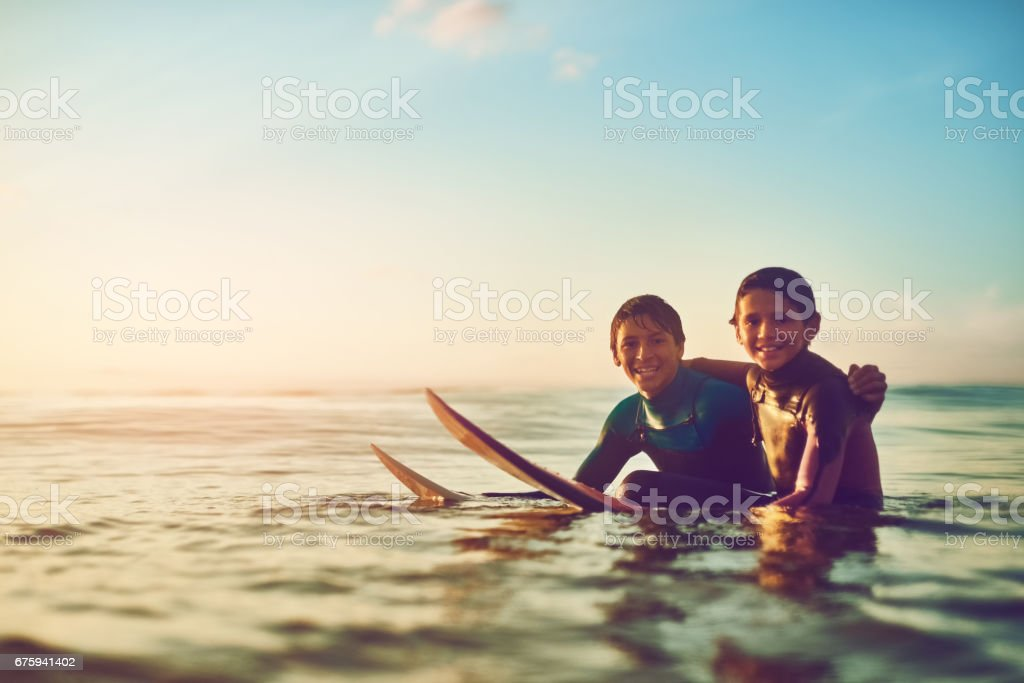 Life is fun when you're out surfing with a buddy stock photo