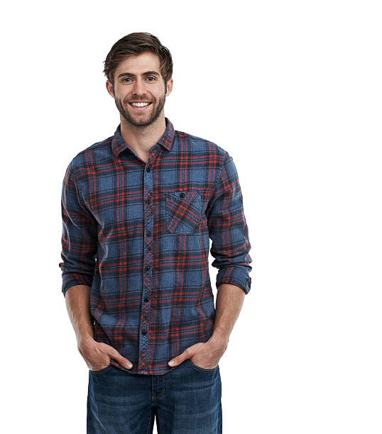 Life is good! Studio portrait of a smiling young man standing with his hands in his pockets isolated on white hands in pockets stock pictures, royalty-free photos & images