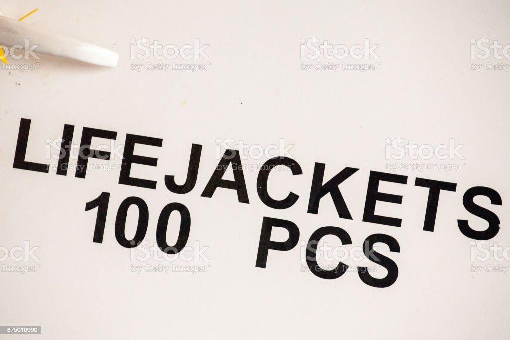 Life jacket sign on white paint stock photo