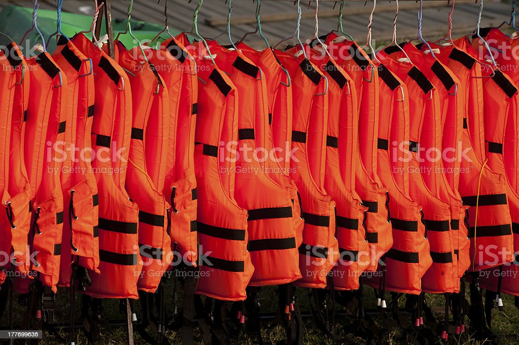 Life jackets on hangers . stock photo