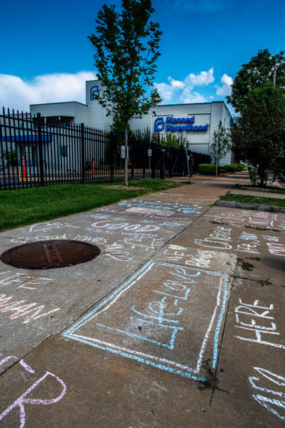 """Life = Love"" and other Christian slogans written in chalk by protestors outside facility that performs abortions Saint Louis, MO—Aug 3, 2019; Planned Parenthood signs displayed on outside of women's health clinic.  St. Louis host the last remaining medical facility that conducts abortions in the State. planned parenthood federation of america stock pictures, royalty-free photos & images"
