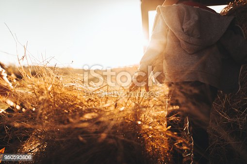 Photo of a little boy showing his life on a family farm