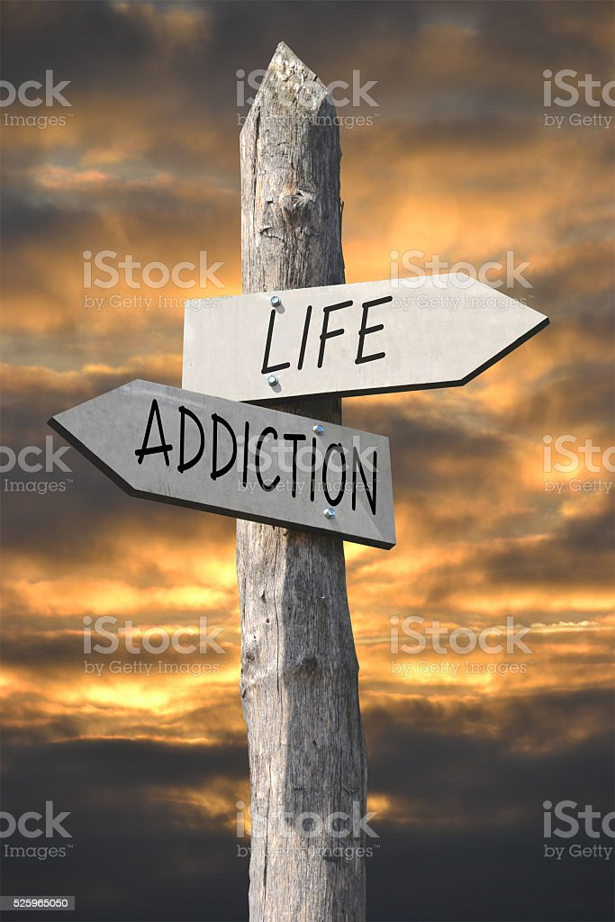 Life or death signpost stock photo