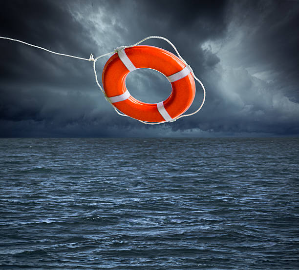 Life Preserver Lifesaver, Thrown in Mid-air for Rescue at Sea stock photo