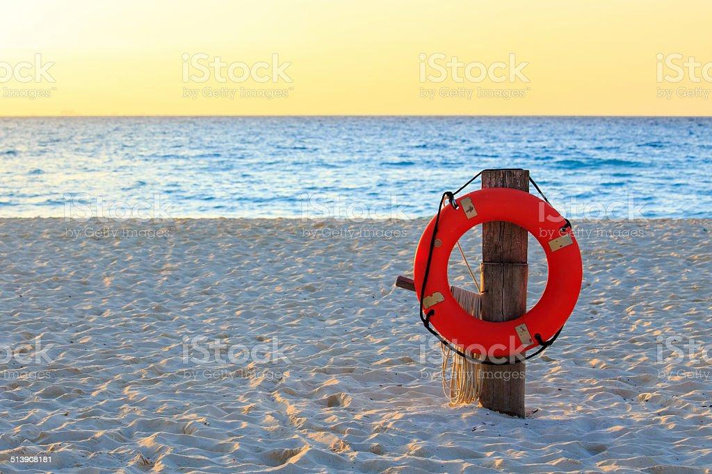 Life preserver on sandy beach stock photo