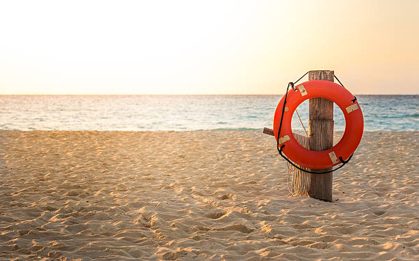 Life preserver on sandy beach Life preserver on sandy beach somewhere in Mexico buoy stock pictures, royalty-free photos & images
