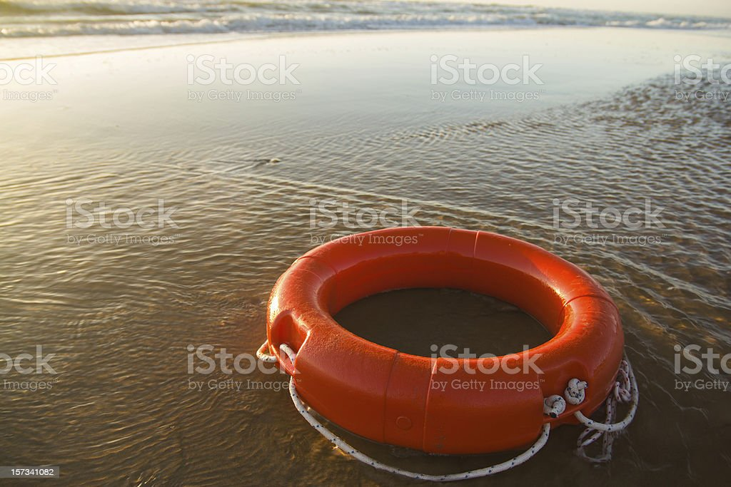 A red Life ring on coast line