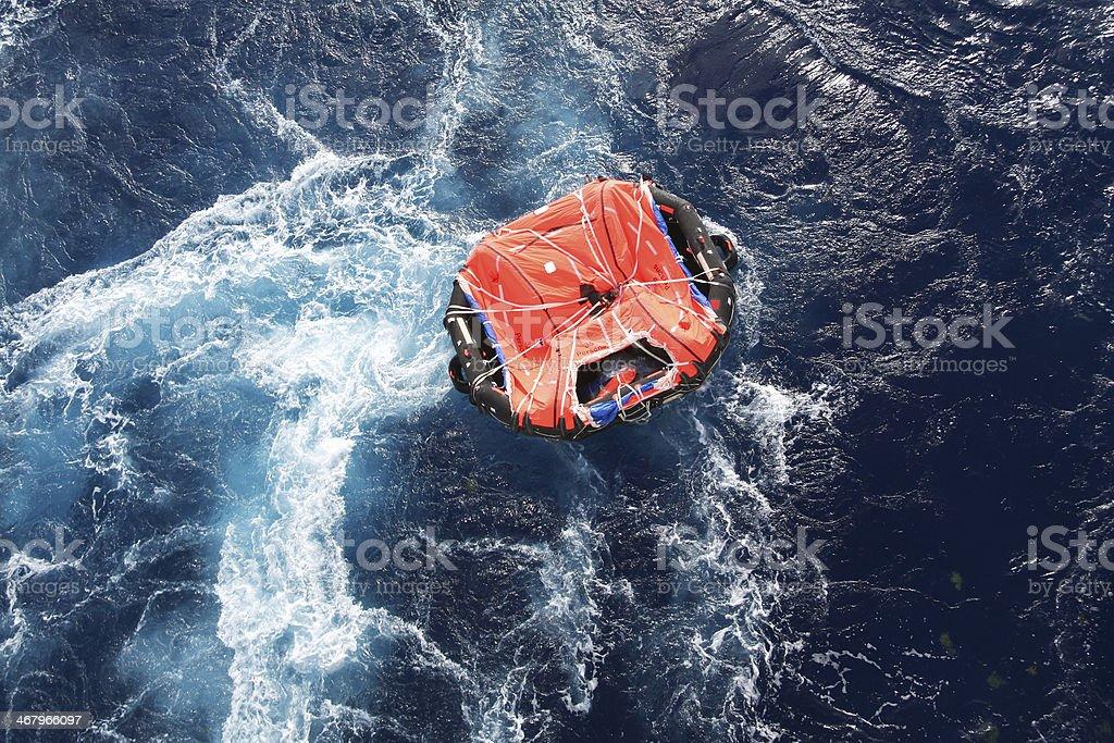 Life Raft Adrift in Mid Ocean stock photo