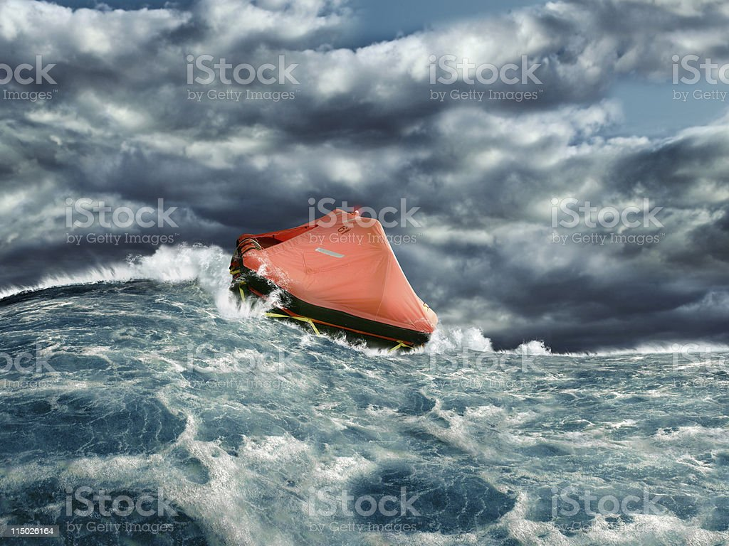Life raft in stormy ocean stock photo