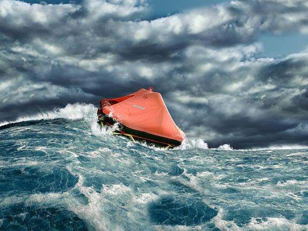 life raft in stormy ocean - livbåt bildbanksfoton och bilder