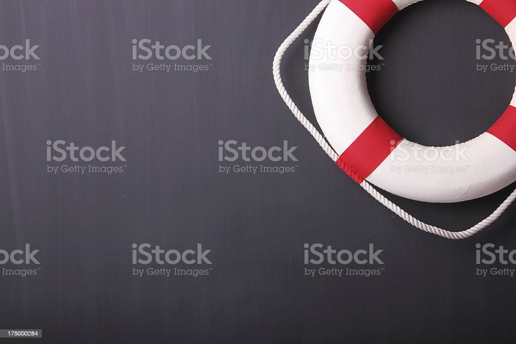 Life Ring Against Dark Background stock photo