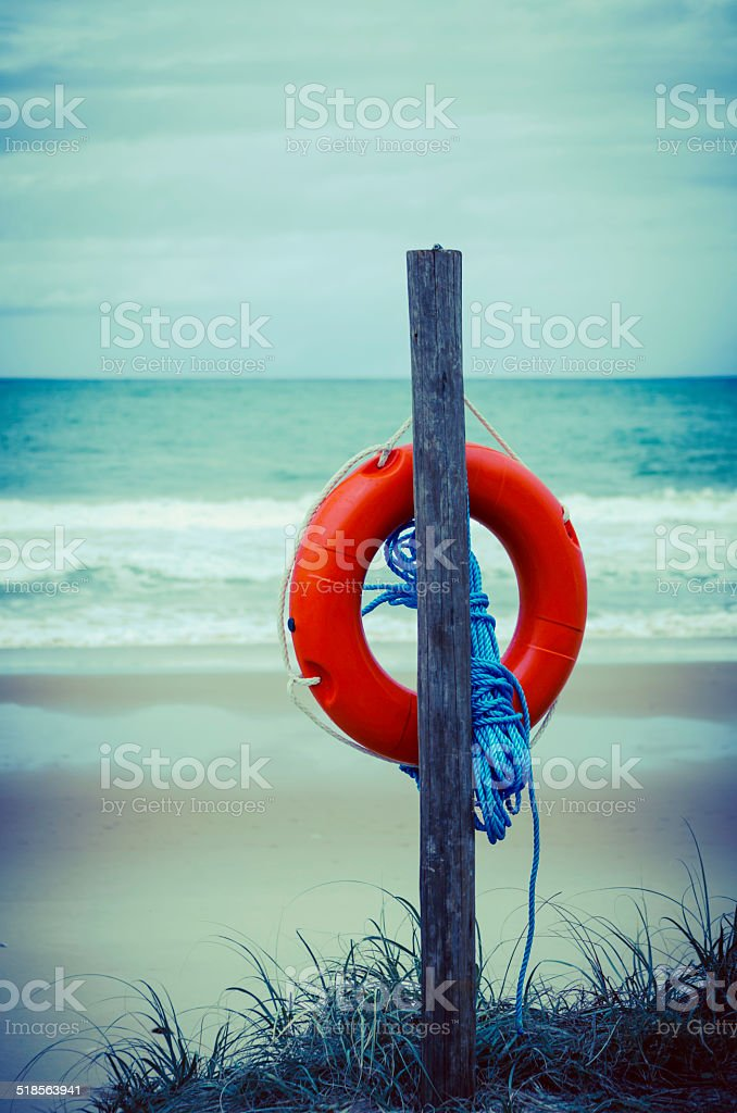life ring at the beach stock photo