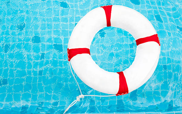 Life Ring at the swimming pool. Life Ring on water. stock photo
