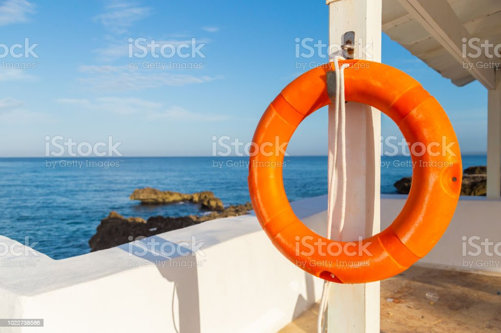 life ring by the pool. Sea view stock photo