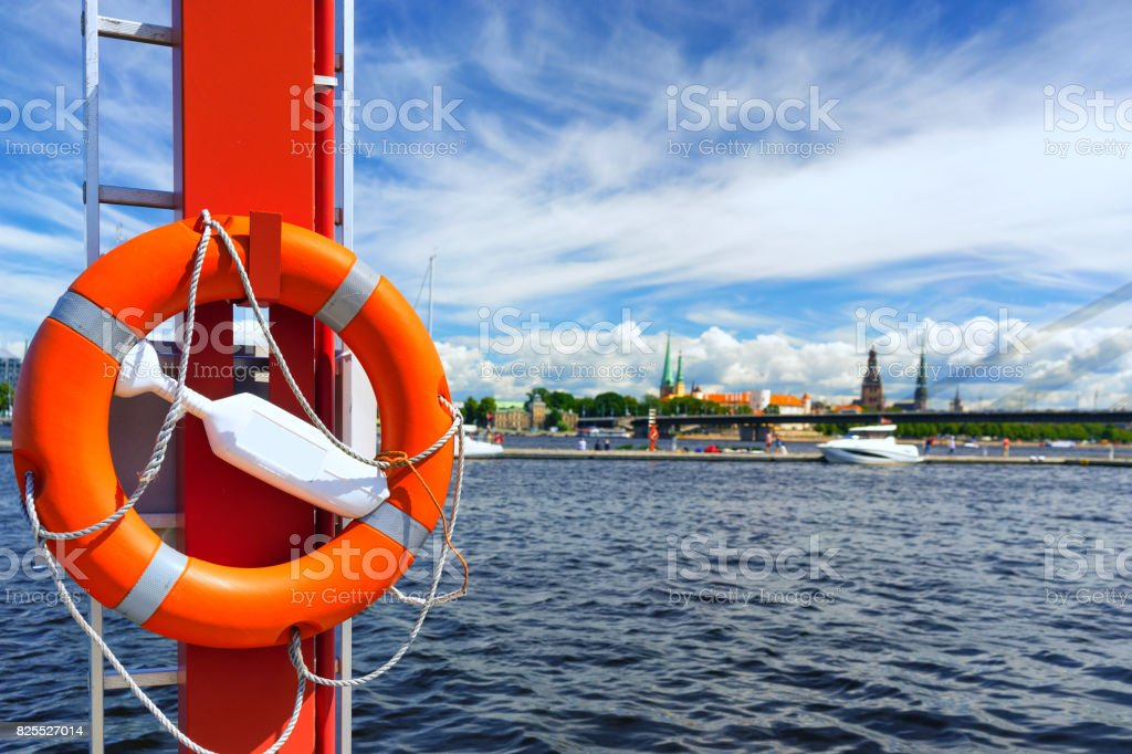 Life ring in the background of the city of Riga stock photo