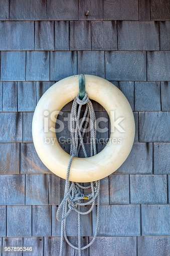 Life ring on wooden cottage