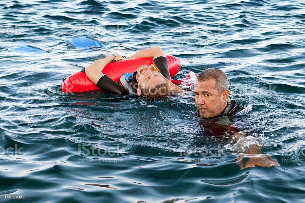 Life Saver man rescue to the woman stock photo