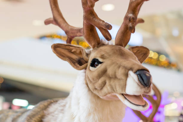 Life sized reindeer plush doll at the department store stock photo