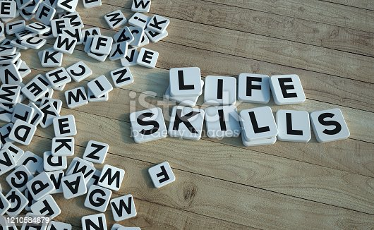 3D rendering of the words life skills written on letter tiles against a wooden background