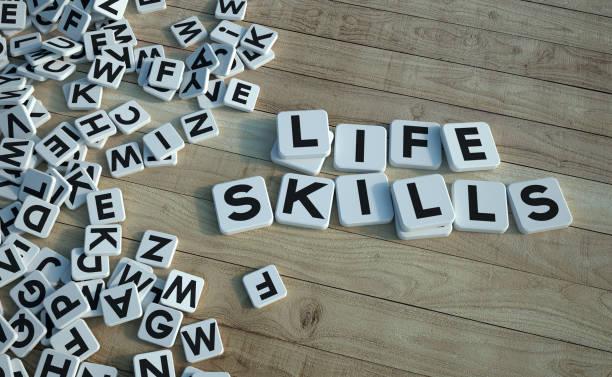 Life skills written in letter tiles wood stock photo