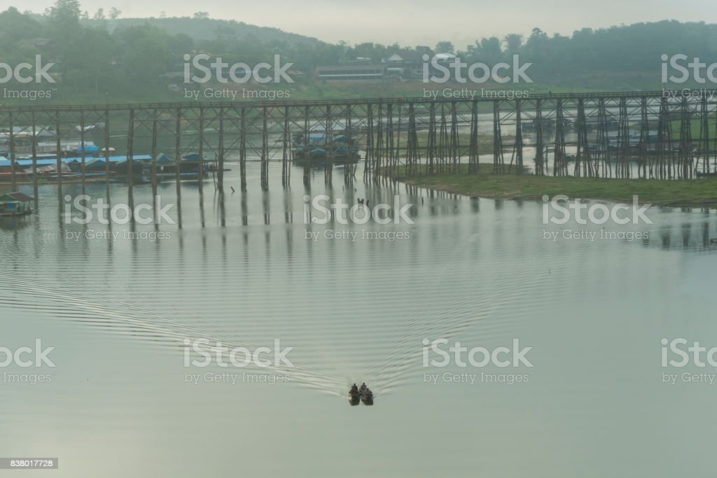 Life style with a boat in a large reservoir in Sangklaburi Kanchanaburi, Thailand stock photo