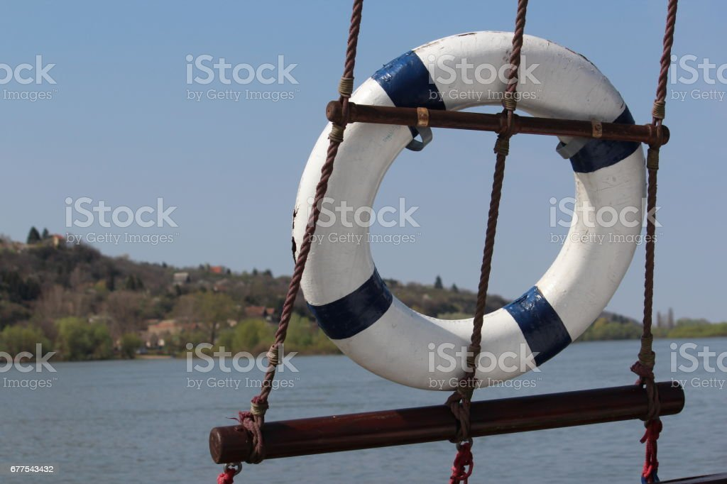 Life vest on the boat ropes royalty-free stock photo