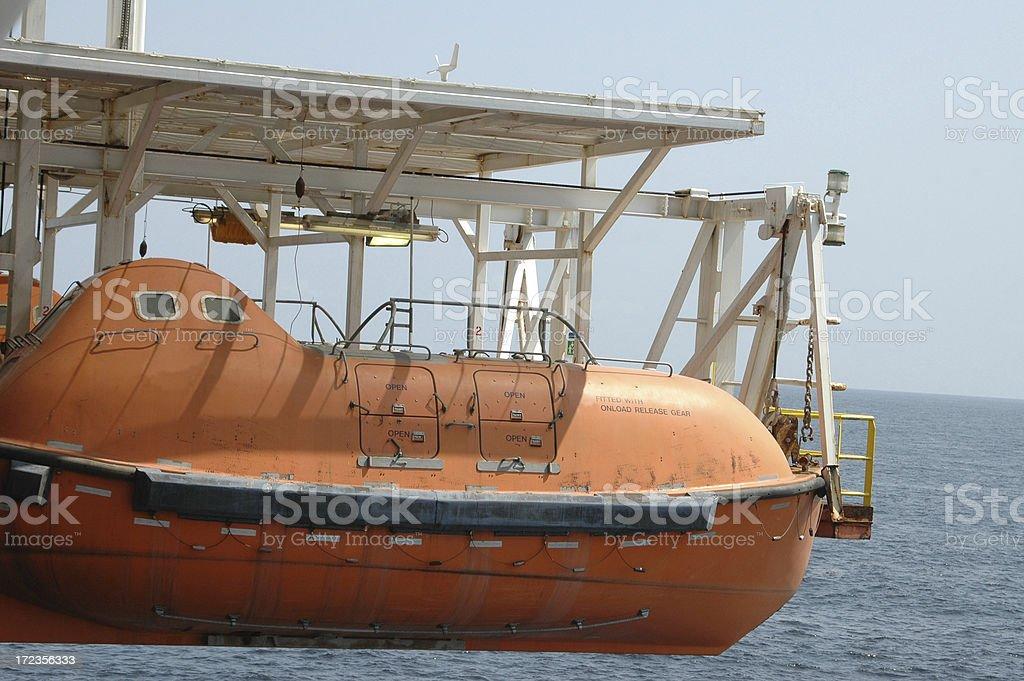 Lifeboat at the rig royalty-free stock photo