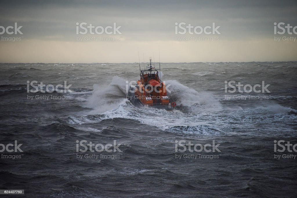 Lifeboat in a storm stock photo